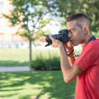 Young man with photo camera  — Stock Photo