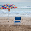Stock Photo: Umbrelland chair on beach