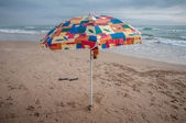 Umbrella on the beach — Stock Photo