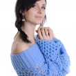 Royalty-Free Stock Photo: A girl in a blue transparent knitted sweater on a white background