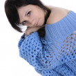 A girl in a blue transparent knitted sweater on a white background — Stock Photo