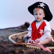 Cute little boy in the pirate costume — Stock Photo #12357417