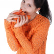 Young beautiful girl eating carrots — Stock Photo
