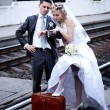 Newly-married couple on tracks — Stock Photo