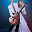 Young wedding couple with guitar and microphone — Stock Photo