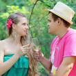 Young happy couple celebrating with champagne at picnic — Stock Photo