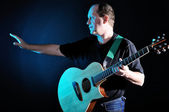 Man with guitar — Stock Photo