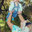 Mother and baby in park — Stock Photo #13413809