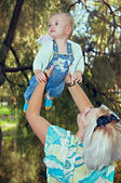 Mother and baby in park — Stock Photo