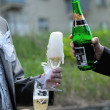Two men pouring Champagne outdoors hands closeup — Stock Photo #22514877