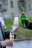 Two men pouring Champagne outdoors hands closeup — Stock Photo