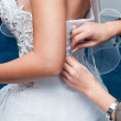 Bride dressing up corset — Stock Photo