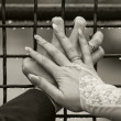Hands with wedding rings on the cell. Vintage style photo — Stock Photo