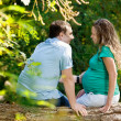 Pregnant woman with her husband on nature — Stock Photo
