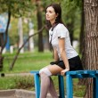 Portrait of beautiful girl student sitting on the bench — Stock Photo #30641083