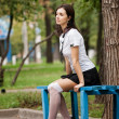 Portrait of beautiful girl student sitting on the bench — Stock Photo