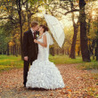 Bride and groom kissing in the park  — Stock Photo