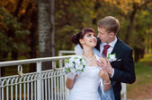 Happy just married couple on the small bridge — Stock Photo