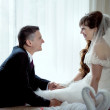 Stock Photo: Newly married couple in room