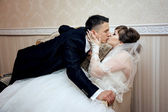Young couple kissing at wedding — Stock Photo
