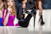 Female shoe in nightclub — Stock Photo