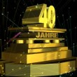 "Stock video: Golden sign ""40 years"" (on german) with fireworks"