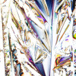 Microcrystals of tartaric acid in polarized light - Stock Photo