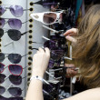 Women choose sunglasses — Stock Photo