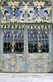 Gilded figured lattice on the doors — Stock Photo