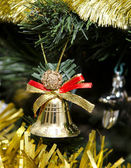 Bell and other toys on the Christmas tree — Stock Photo