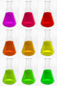 Chemical glass retorts with colorful liquid — Stock Photo