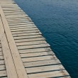 Stock Photo: Wooden jetty over rippling water