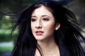 Woman with windblown hair — Stock Photo