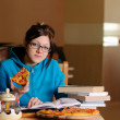 Stock Photo: Beautiful college student in pizzeria
