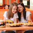Beautiful young women eating pizza — Stock Photo #13623492