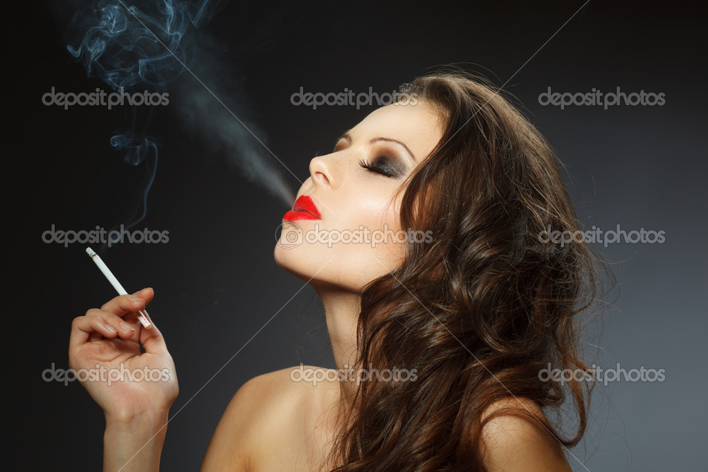 Beauty portrait of young brunette woman with cigarette, studio shot — Stock Photo #14275813
