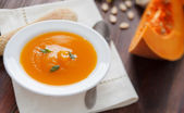 Pumpkin soup in white bowl — Stock Photo