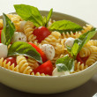 Stock Photo: Pastsalad with cherry tomatoes and basil leaves