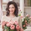 Stock Photo: Beautiful young woman with flowers. Retro styled