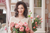 Beautiful young woman with flowers. Retro styled — Stock Photo