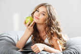 Young cute girl with apple — Stock Photo