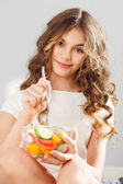 Young cute girl with salad — Stock Photo