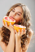 Young cute girl with grapefruit — Stok fotoğraf