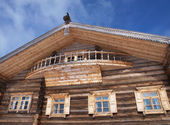 A facade of a traditional russian wooden house — Stock Photo