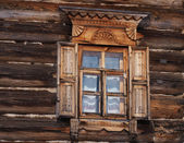 A window of a traditional russian wooden house — Stock Photo