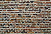 Old parti-colored brick wall — Stock Photo