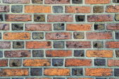 Parti-colored brick wall — Stock Photo