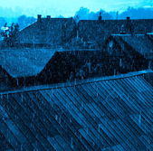Rain over the rooftops — Stock Photo