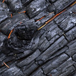 A charred wood with bulges — Stock Photo