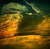 Rainbow wavelets in water — Stock Photo